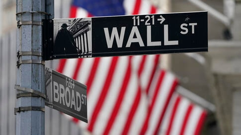 A street sign is displayed at the New York Stock Exchange in New York, Monday, Nov. 23, 2020. Stocks are off to a good start on…