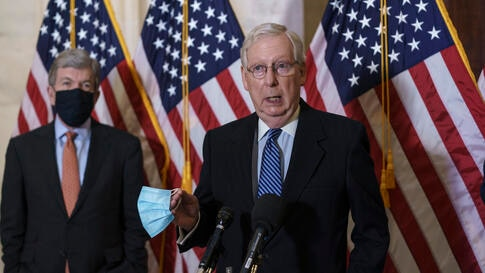 Senate Majority Leader Mitch McConnell, R-Ky., joined at left by Sen. Roy Blunt, R-Mo., talks briefly to reporters after the…