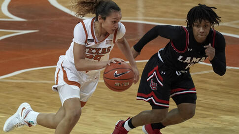 Texas' Ashley Chevalier (25) drives against Lamar's Kayla Mitchell (0) during the first half of an NCAA college basketball game…