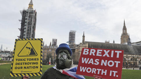 A pro EU protestor stands in parliament square in front of Parliament during the debate in the House of Commons on the EU …