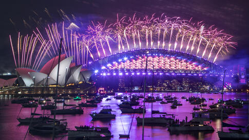 Fireworks explode over the Sydney Opera House and Harbour Bridge as New Year celebrations begin in Sydney, Australia, Thursday,…