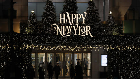 Visitors wearing face masks walk near a New Year banner at a department store in Seoul, South Korea, Thursday, Dec. 31, 2020. …