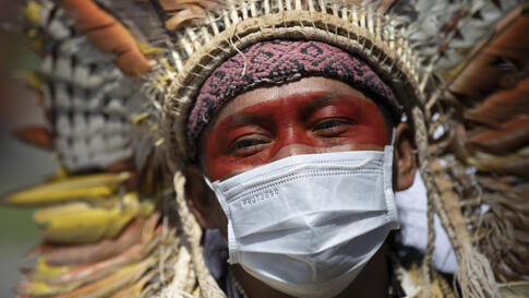 Ninawa Inu Huni kui, 40, protests against auctions for the exploration of oil fields in the Amazons outside an hotel in Rio de…