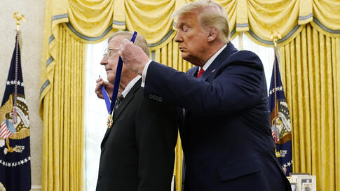 President Donald Trump awards the medal of Freedom, the highest civilian honor, to former college football coach Lou Holtz at…