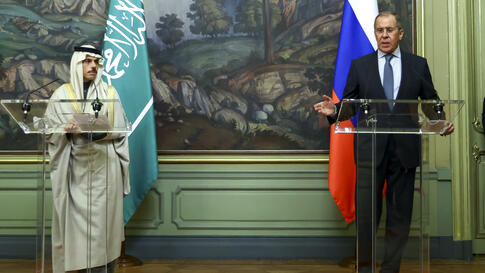 Russian Foreign Minister Sergey Lavrov, right, and Saudi Foreign Minister Prince Faisal bin Farhan Al-Saud attend a joint news…