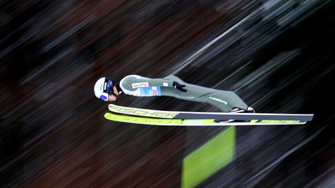 Kamil Stoch of Poland soars through the air during his trial jump at the fourth stage of the 69th four hills ski jumping…