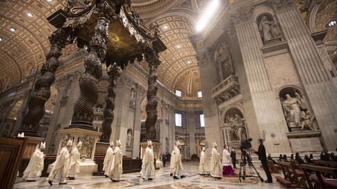 Clergy arrive in procession to attend a new year Mass in St. Peter's Basilica at the Vatican, Friday, Jan. 1, 2021. (AP Photo…