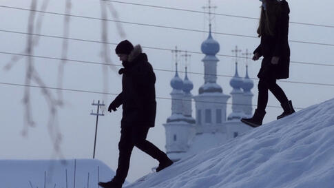 People go down the hill past the Trinity Church in the city of Totma, about 600 km (370 miles) northeast of Moscow, Russia,…