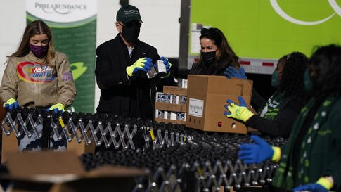 President-elect Joe Biden participates in a National Day of Service event at Philabundance, a hunger relief organization, with…