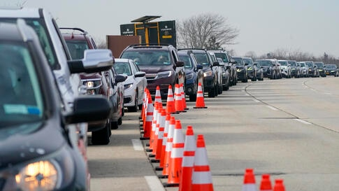 Cars line up to enter the New York State Nassau COVID-19 drive-through vaccination site at Jones Beach State Park, Thursday,…