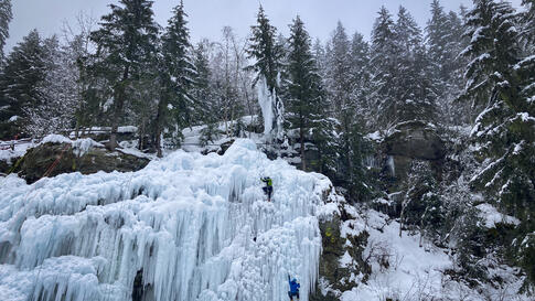 Climbers scale a wall of ice in the forest near the village of Les Contamines-Montjoie, in the Haute Savoie region of France…