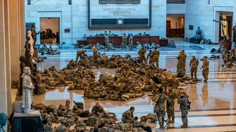 Hundreds of National Guard troops hold inside the Capitol Visitor's Center to reinforce security at the Capitol in Washington,…