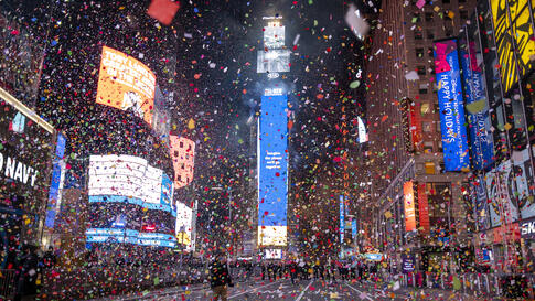 Confetti flies after the Times Square New Year's Eve Ball drops in a nearly empty Times Square, early Friday, Jan. 1, 2021, as…