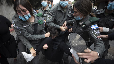Israeli border police detain a Palestinian protester during a demonstration against a visit by Israeli Prime Minister Benjamin…