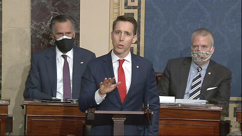 In this image from video, Sen. Josh Hawley, R-Mo., speaks as the Senate reconvenes to debate the objection to confirm the…