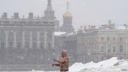 A man bathes in an ice hole in the Neva River in St. Petersburg, Russia, Wednesday, Jan. 13, 2021. The temperature in St…