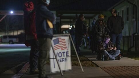 Voters wait in line to cast their ballots in Georgia's Senate runoff elections at a senior center, Tuesday, Jan. 5, 2021, in…