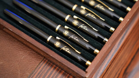 Pens featuring President Joe Biden's signature and presidential seal, are displayed in the State Dinning Room of the White…