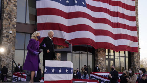 "President-elect Joe Biden stands with his wife Jill Biden after speaking at the Major Joseph R. ""Beau"" Biden III National Guard…"