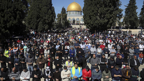 Muslim worshippers take part in Friday prayers at the Dome of the Rock Mosque in the Al Aqsa Mosque complex in the Old City of…