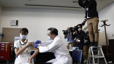 A medical worker receives a dose of COVID-19 vaccine Tokyo Medical Center in Tokyo Wednesday, Feb. 17, 2021. Japan's first…