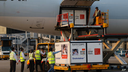 Containers carrying Sinovac Biotech coronavirus disease (COVID-19) vaccines are unloaded from a Cathay Pacific Airways aircraft…