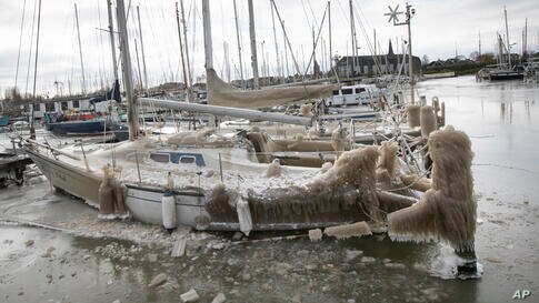 Icicles form on a ship in the marina of Monnickendam, Netherlands, Tuesday, Feb. 9, 2021. With freezing temperatures forecast…