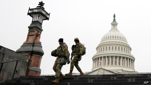 Members of the National Guard patrol the area outside of the U.S. Capitol during the impeachment trial of former President…