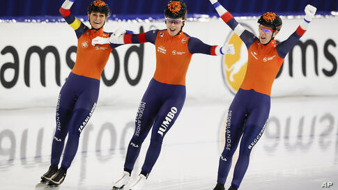Team Netherlands with Irene Schouten, Antoinette de Jong, and Ireen Wust, from left to right, celebrates winning the gold medal…