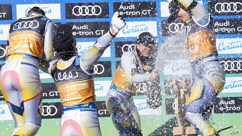 Team Norway celebrates their gold medal in the mixed team parallel slalom, at the alpine ski World Championships in Cortina d…