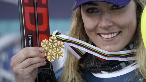 United States' Mikaela Shiffrin shows her gold medal for the women's combined race, at the alpine ski World Championships, in…