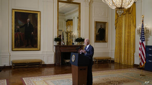 President Joe Biden speaks during a virtual event with the Munich Security Conference in the East Room of the White House,…
