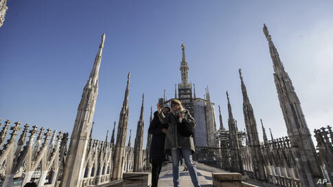 Visitors take selfies on the roof of the Duomo gothic cathedral, in Milan, Italy, Thursday, Feb. 11, 2021. The Duomo cathedral…