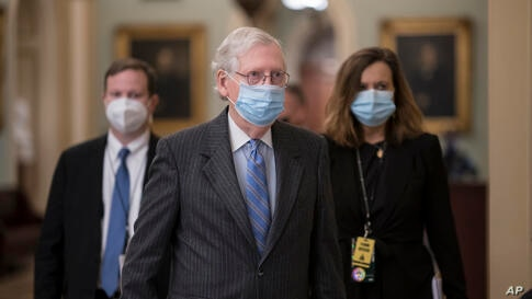 Senate Minority Leader Mitch McConnell, R-Ky., returns to his office before the start of the second impeachment trial of former…