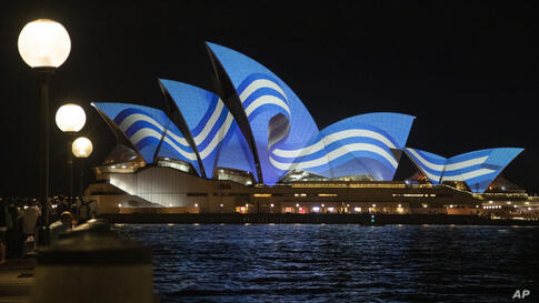 The Greek flag is projected onto the sails of the Sydney Opera House to mark the 200th anniversary of the Greek War of…