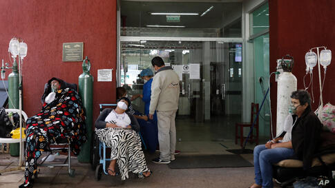 COVID-19 patients wait for space at the entrance to the Villa Elisa Hospital in Villa Elisa, Paraguay, Monday, April 26, 2021. …