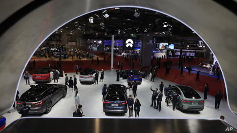 Visitors look at the latest cars from Chinese automaker NIO during the Shanghai Auto Show in Shanghai on Tuesday, April 20,…