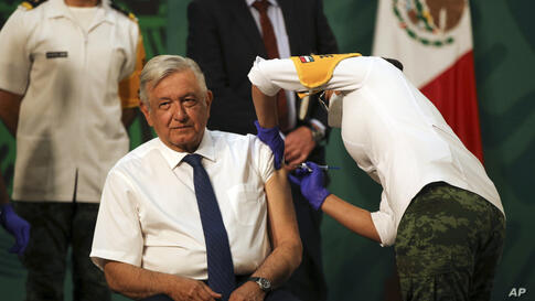 Mexican President Andres Manuel Lopez Obrador gets a shot of the AstraZeneca vaccine for COVID-19 during his daily, morning…