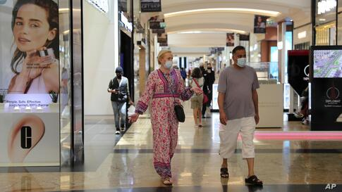 People walk in Mall of the Emirates, in Dubai, United Arab Emirates, Thursday, April 15, 2021. The Middle East's largest…