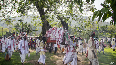Villagers participate in a religious procession during the traditional Gohain Uliuwa Mela in Mayong village, about 50…