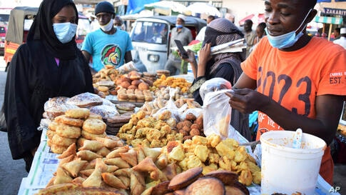 A street vendor prepares his stall in Mombasa town Kenya, Wednesday April 28, 2021, to sell food for the fasting muslims…