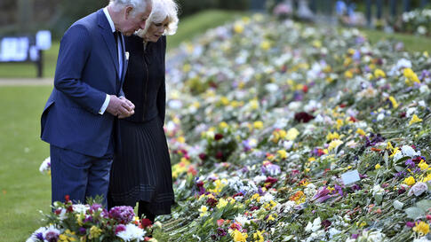 Britain's Prince Charles and Camilla, Duchess of Cornwall visit the gardens of Marlborough House, London, Thursday April 15,…
