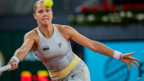 United States' Shelby Rogers returns the ball to Ashleigh Barty of Australia during their match at the Mutua Madrid Open tennis…
