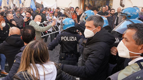 Demonstrators scuffle with Italian Policemen during a protest by Restaurant and shop owners outside the Lower Chamber in Rome,…