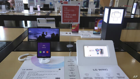 LG Electronics Inc.'s dual-screen smartphone, the Wing, is displayed at a mobile phone shop in Seoul, South Korea, Monday,…