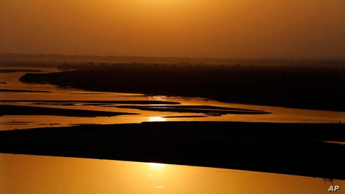 Sun set on the Ganges river basin, one of India's holiest rivers with falling levels of water in its lower reaches on the world…