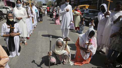 Christians participate in a procession to mark Good Friday in Jammu, India, Friday, April 2, 2021. Christians all over the…