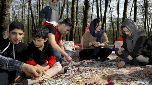 People play bingo game while enjoying the annual public picnic day on the 13th and last day of the Persian New Year, or Nowruz,…