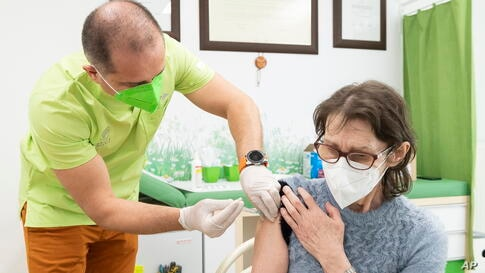 A general practitioner administers the first dose of AstraZeneca's COVID-19 to a patient in his office in Nyiregyhaza, Hungary,…