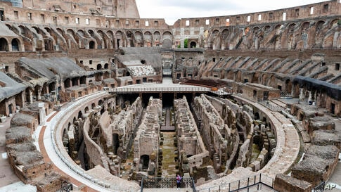 A few visitors arrive for their tour of the Colosseum in Rome, Tuesday, April 27, 2021. The ancient Roman gladiator arena…
